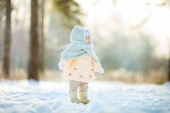 Winter portrait of little girl in fur coat royalty free stock images