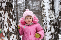 Winter portrait of the little girl in the pink Stock Images