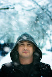 Winter Portrait of a man wearing hood in snow Royalty Free Stock Photo