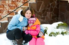 Winter portrait of mother and daughter Royalty Free Stock Photos