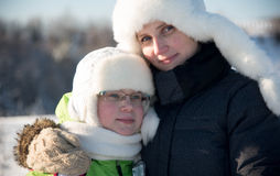 Winter portrait of mother and daughter in white hats royalty free stock photos
