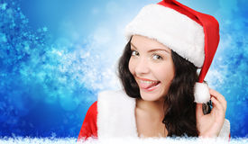 Winter portrait of a playful santa woman Royalty Free Stock Photography