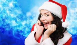 Winter portrait of a playful santa woman stock photography