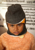 Winter portrait of a sad cute Indian boy Royalty Free Stock Photo