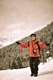 Winter portrait of senior woman in snow mountains Stock Images
