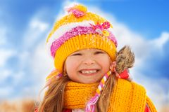 Winter portrait of smiling little girl Stock Photos