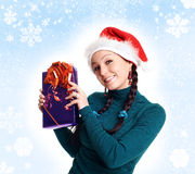 Winter portrait of a smiling woman. With a gift in her hands Royalty Free Stock Images