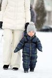 Winter portrait of toddler boy with mother Royalty Free Stock Photos