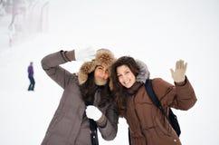 Winter portrait of two beautiful girls Stock Photo