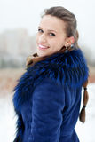 Winter portrait of woman in coat Stock Photos