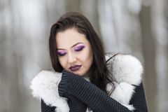Winter portrait with a woman. With colored eyes Royalty Free Stock Images