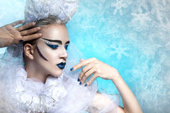 Winter portrait of a woman with creative makeup. Stock Images