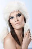 Winter portrait of woman in fur cap Stock Photos