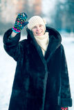Winter Portrait of Woman with a Snow Background Stock Photography