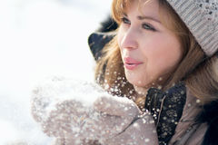 Winter portrait of a woman with snow in hands Royalty Free Stock Photography