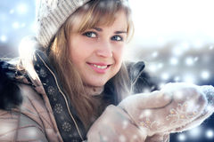 Winter portrait of a woman with snow in hands Stock Photos