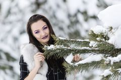 Winter portrait with a woman. With colored eyes Stock Images