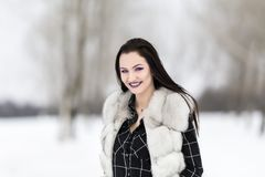 Winter portrait with a woman. With colored eyes Stock Image
