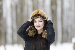 Winter portrait with a woman. With colored eyes Royalty Free Stock Photo