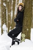 Winter portrait with a woman. With colored eyes Stock Photo