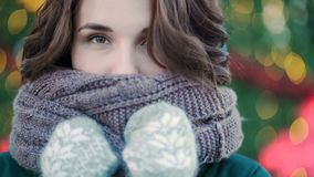 Winter portrait of a young beautiful girl on the streets of a European city. Close-up of beautiful young woman with stock photography