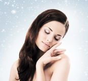 Winter portrait of young and beautiful woman. stock photo