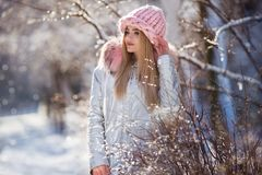 Winter portrait of young beautiful woman wearing warm clothes. Snowing winter beauty fashion concept stock images