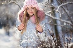 Winter portrait of young beautiful woman wearing warm clothes. Snowing winter beauty fashion concept royalty free stock photo