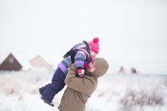 Father and baby walking together, winter, snow. Stock Photo