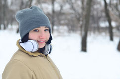 Winter portrait of young girl with headphones Royalty Free Stock Image