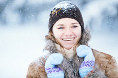 Winter portrait of young happy woman. Royalty Free Stock Images