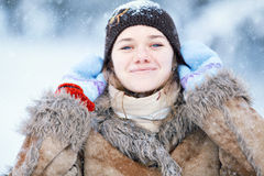 Winter portrait of young happy woman. Stock Photo