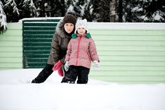 Winter portrait of young mother and daughter Royalty Free Stock Image