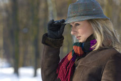 Winter portrait of a young woman. Wearing a scarf and hat Royalty Free Stock Image
