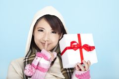 Winter portrait of young woman. Winter portrait of a smiling woman with a gift box Stock Photos