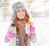 Winter portrait of young woman in fur hat Royalty Free Stock Photos