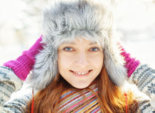 Winter portrait of young woman in fur hat Stock Photography