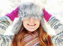 Winter portrait of young woman in fur hat.  Royalty Free Stock Images