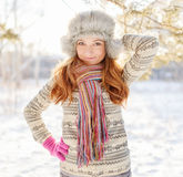 Winter portrait of young woman in fur hat Royalty Free Stock Image