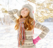 Winter portrait of young woman in fur hat Royalty Free Stock Images
