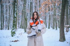 Winter portrait of young woman in the winter snowy scenery. Outdoor portrait of young pretty beautiful woman in cold stock images