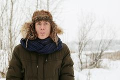Winter portraits of a guy in nature. stock photography