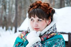 Winter portreit of girl with beautiful hair on her head in Russian folk style in blue shawls stock photos