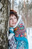 Winter portreit of girl with beautiful hair on her head in Russian folk style in blue shawls royalty free stock image