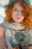 Winter portret. Beautiful young woman drinking a hot chocolate on a cold winter day Royalty Free Stock Photos