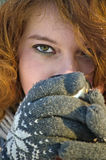 Winter portret. Beautiful young woman drinking a hot chocolate on a cold winter day Royalty Free Stock Image