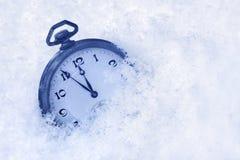Pocket watch in snow Stock Photos