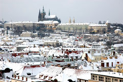 Winter Prague. View on snowy Prague rooftopsa and Prague Castle royalty free stock photography