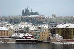 Winter Prague. View on snowy Prague rooftopsa and Prague Castle from Vltava river royalty free stock photography