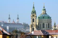 Winter Prague. Church of Saint Nicolas and Strahov Monastery royalty free stock images